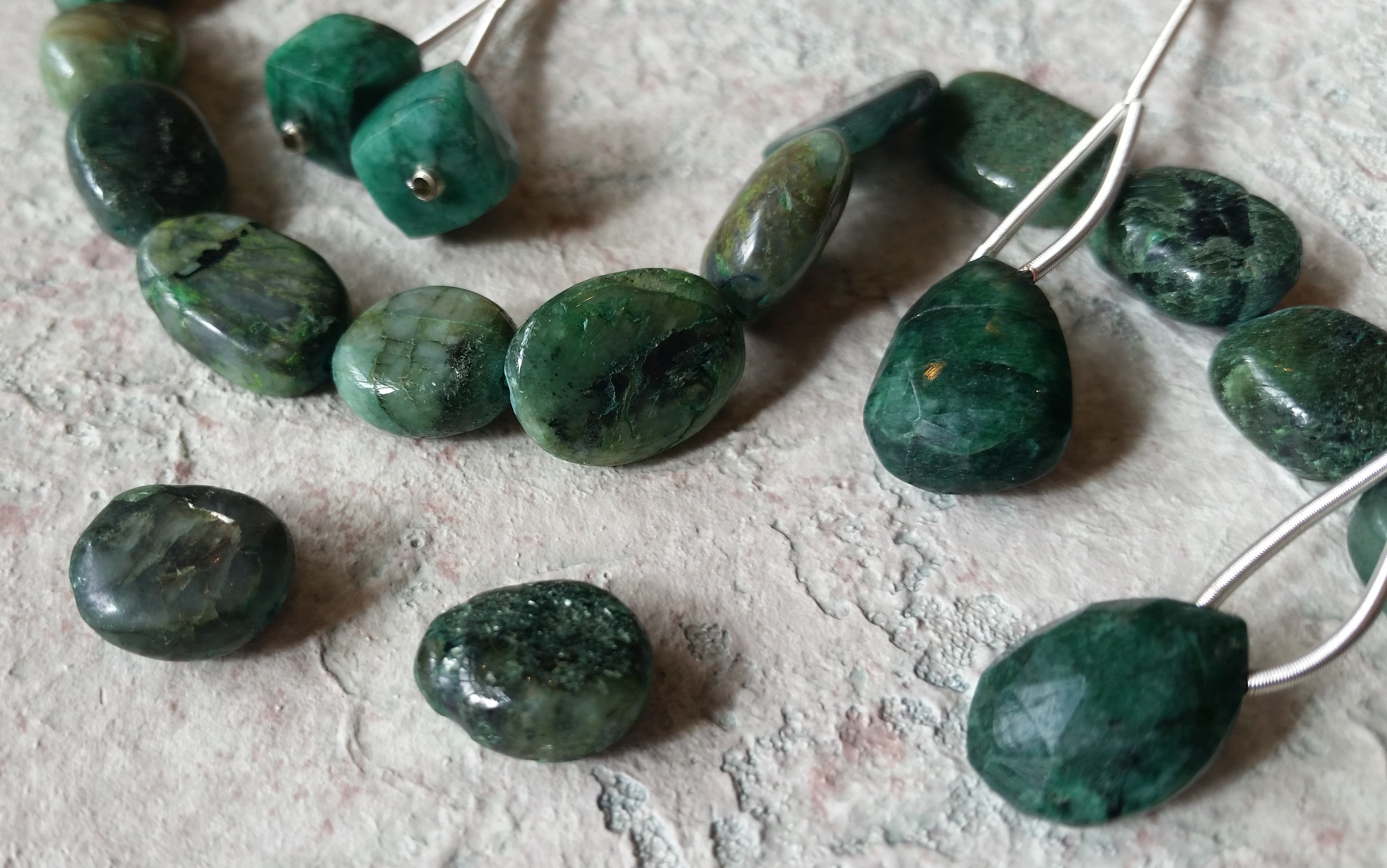 Image of a strand of emeralds, and emeralds pairs and pendants