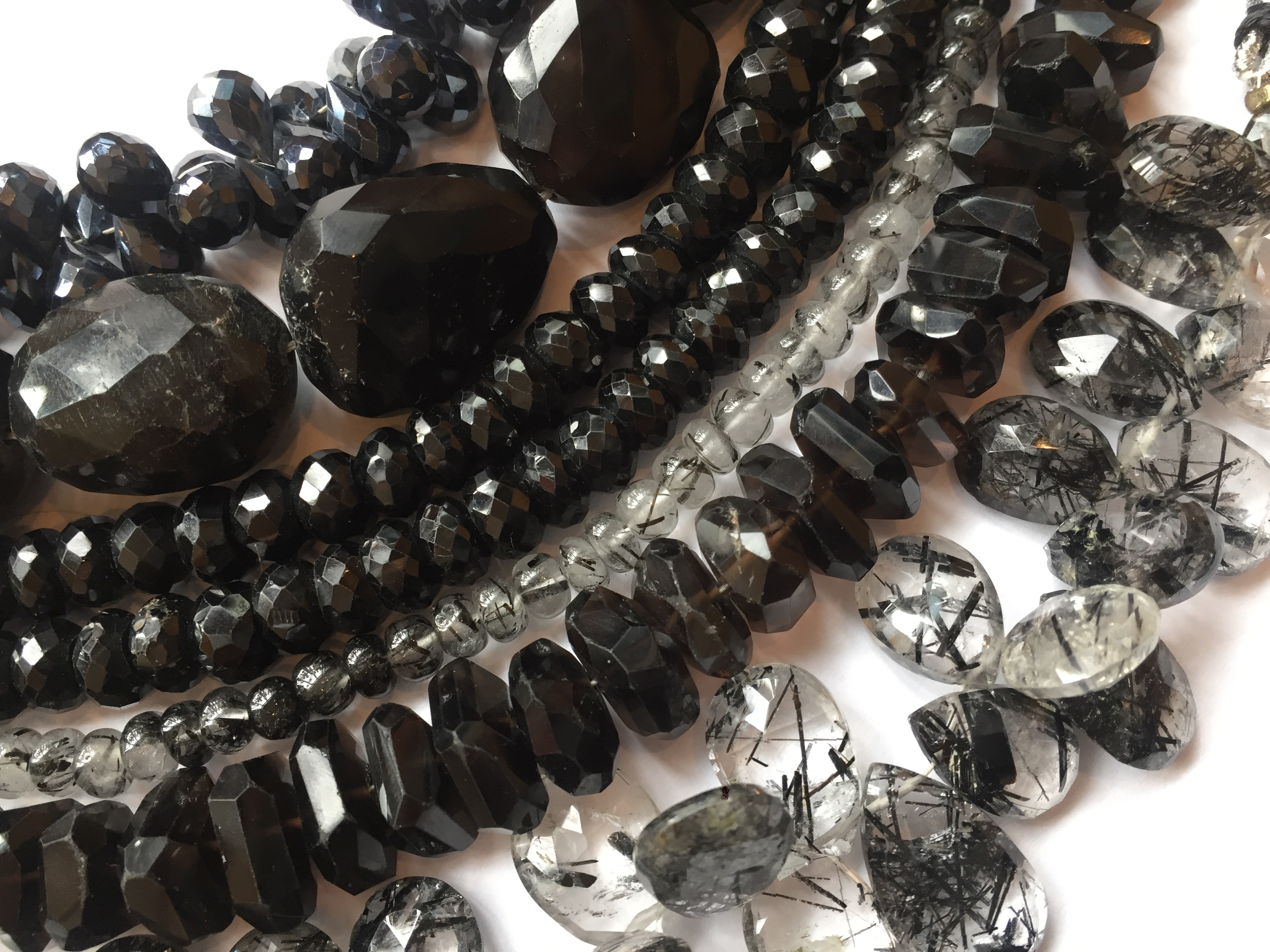 strands of black and clear gemstone beads