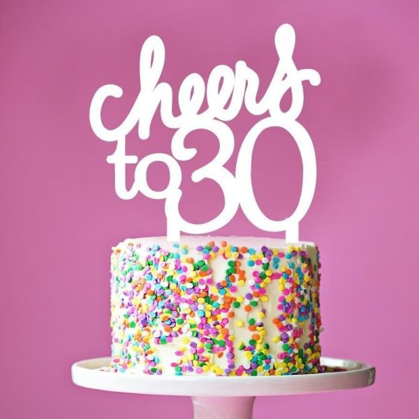 "birthday cake with topper that reads ""cheers to 30"""