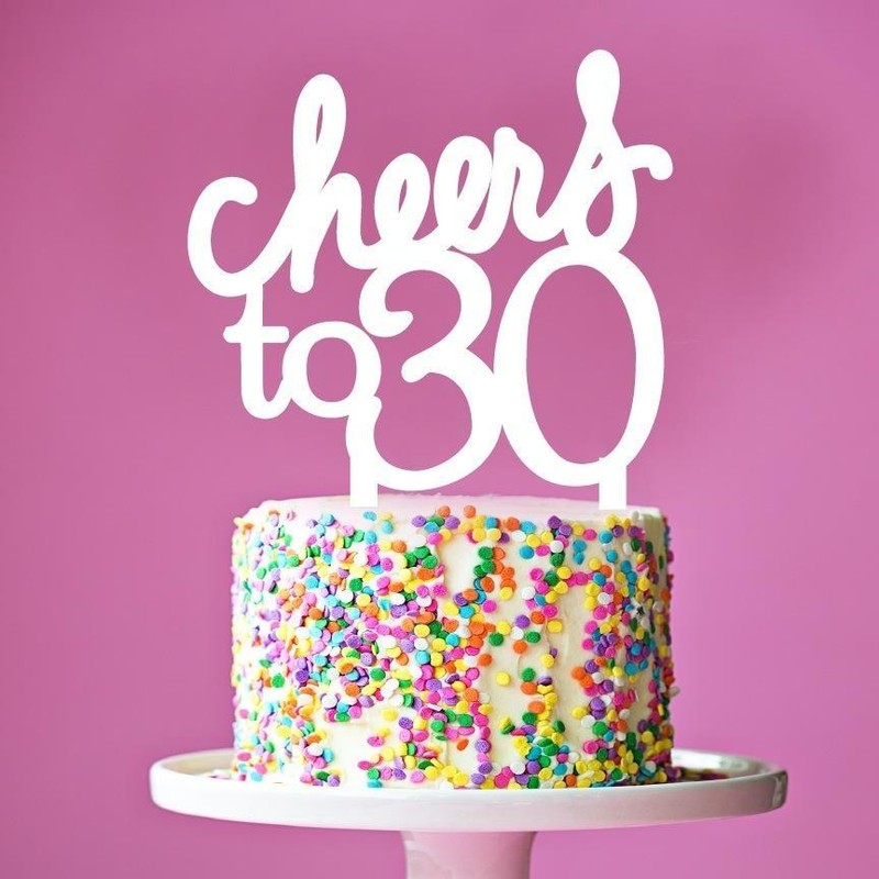 """birthday cake with topper that reads """"cheers to 30"""""""