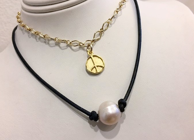 Layered choker necklaces with gold chain and charm and a freshwater pearl gemstone bead